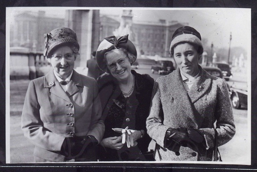 A black and white image of three women wearing hats, taken in 1961