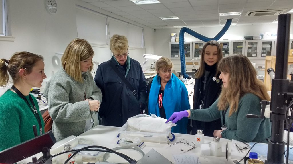 In the NMCC artefact conservation lab with from LtoR: Bethan Bryan, Assistant Artefact Conservator, Anna Gordon, Simone ten Hompel, Corrine Julius, Sarah Rothwell, Curator, Modern & Contemporary Design, and Mary Davis, Artefact Conservator (Galloway Hoard)