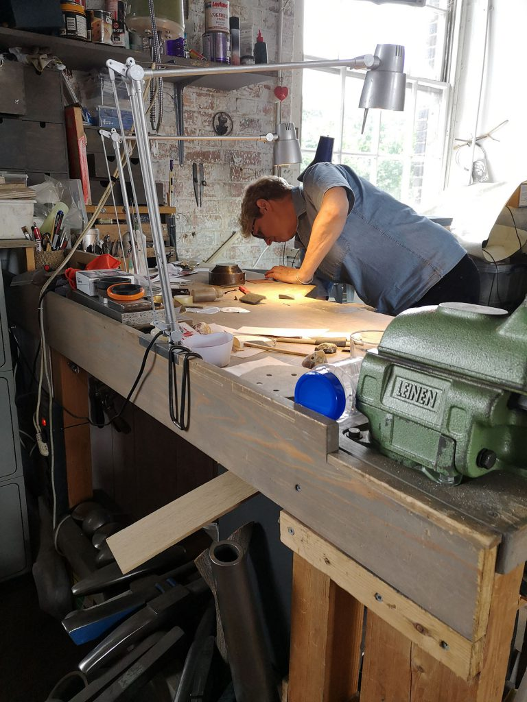 Simone ten Hompel in her studio in London hiding from my camera to fish out a piece of metal.