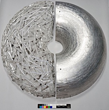 Sculpture consisting of a semi-circle of metal and a semi-circle made from glass rods.