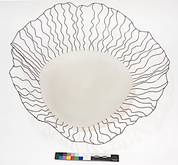 Verve sculpture made from glass with copper wires radiating from it to form a basket shape