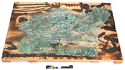 Glass and wood sculpture entitled Wall Piece, with broken glass at the bottom.