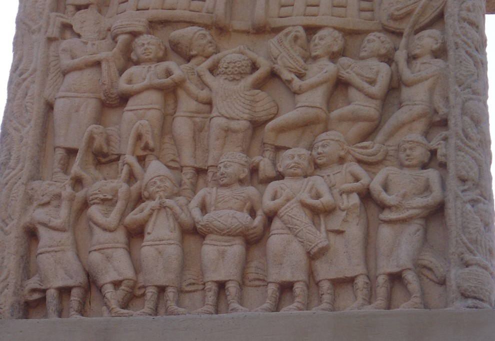 wo carnyx players shown in a band on a stupa at Sanchi, central India.