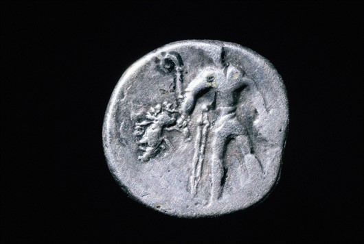 Gaulish coin showing a warrior holding a carnyx and board standard