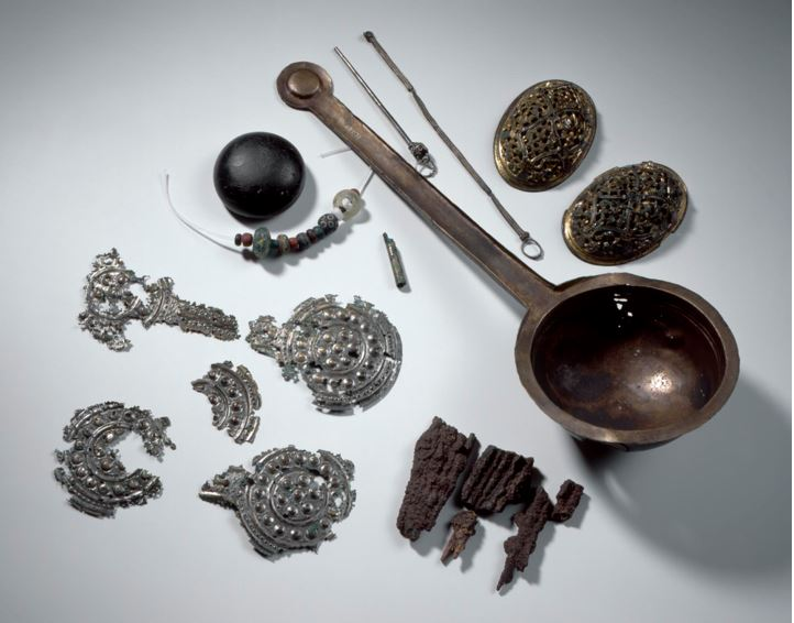 Finds from a grave in Ballinaby, on the island of Islay,, with a bronze ladle in the middle