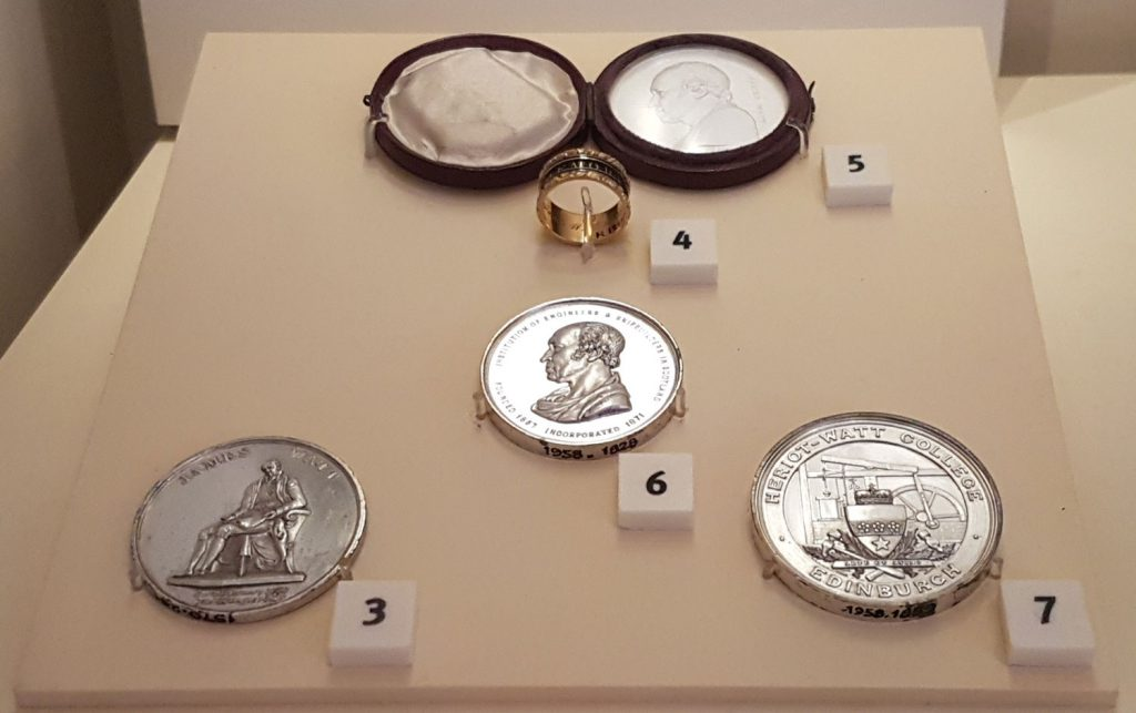 Four silver medals commemorating Watt's life and achievements, and a mourning ring made in his memory.