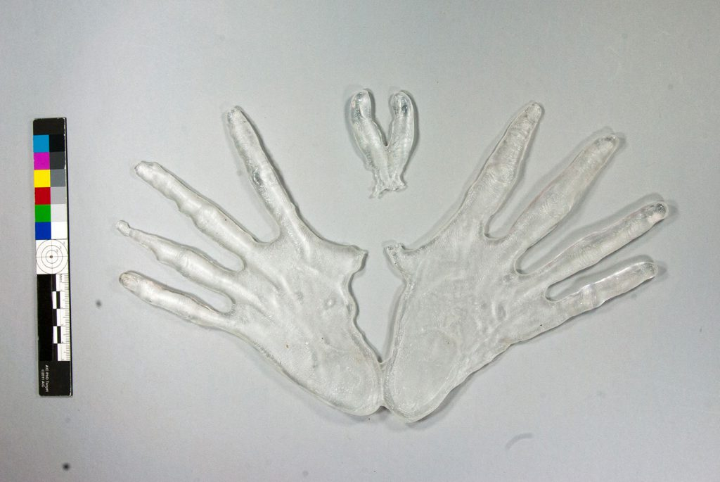 The glass section of 'Form' before treatment - a sculpture of hands with palms touching at the sides and fingers outstretched