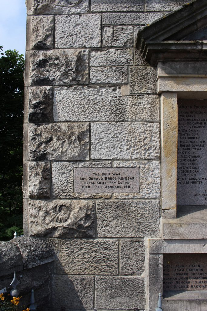 War Memorial at Brora, with an ammonite in the stone