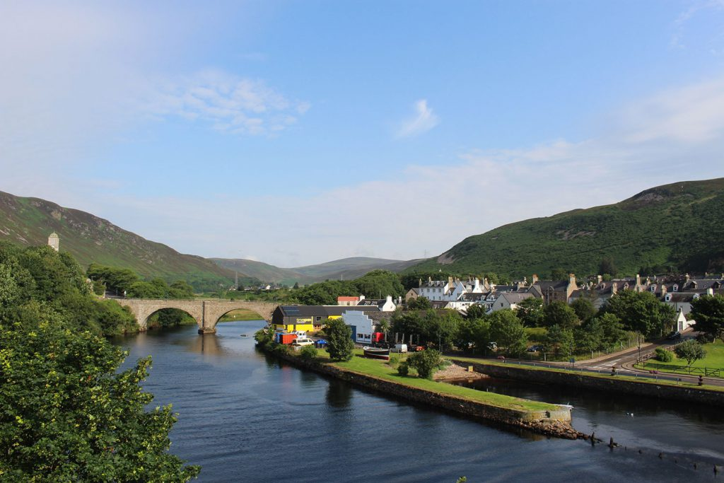 Helmsdale on a sunny day, showing the river and bridge