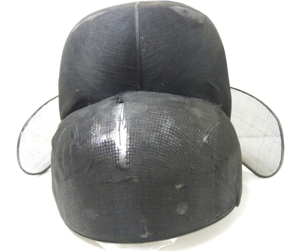 The front of a Korean court officials hat before conservation.