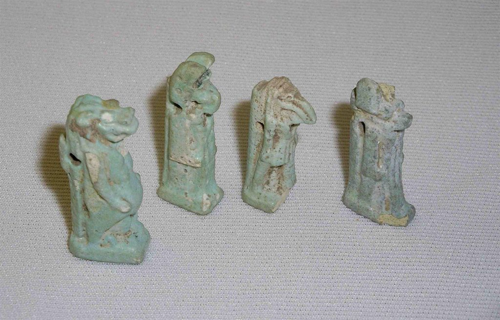 Four pale green amulets.