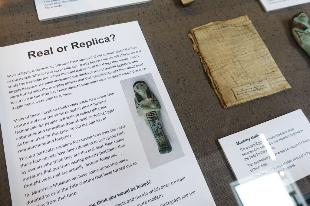 Real or Replica display at Montrose Museum, showing information sheets.
