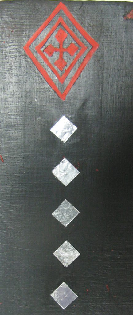 Sample pattern for the side of the throne, silver and red lozenges on black.