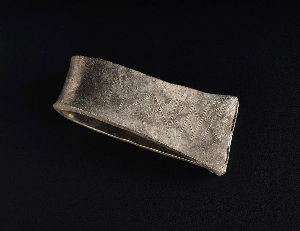 Folded silver arm-ring inscribed with the name Egbert.