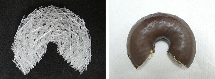 The glass area of the sculpture and a chocolate donut with a bite taken out of it - both are the same shape!