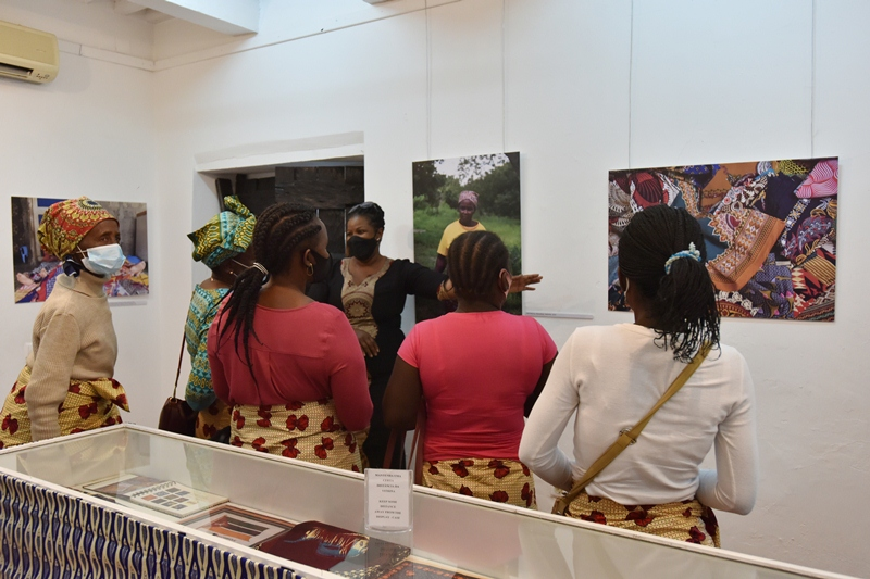 Groups of people wearing masks looking around an exhibition.